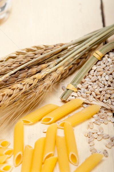 Italian pasta penne with wheat Stock photo © keko64