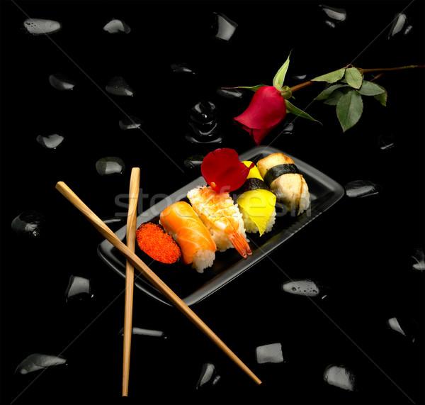 Szusi tányér rózsa fekete kavicsok hal Stock fotó © keko64