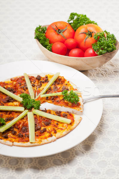 Turkish beef pizza with cucumber on top Stock photo © keko64