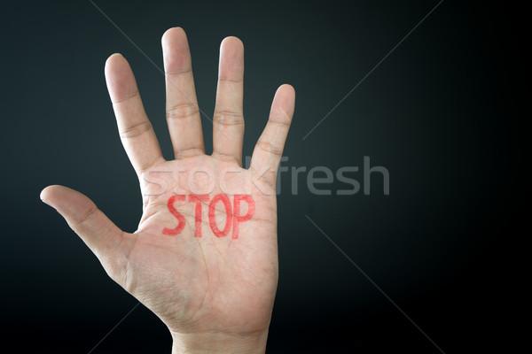 Mão sinal de parada isolado preto fundo palma Foto stock © kenishirotie