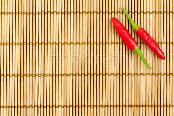Red chilli on a bamboo mat Stock photo © kenishirotie