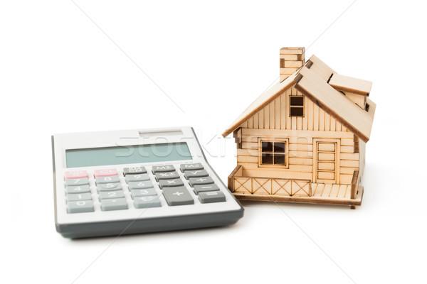 Lakáshitel számológép miniatűr ház modell izolált Stock fotó © kenishirotie