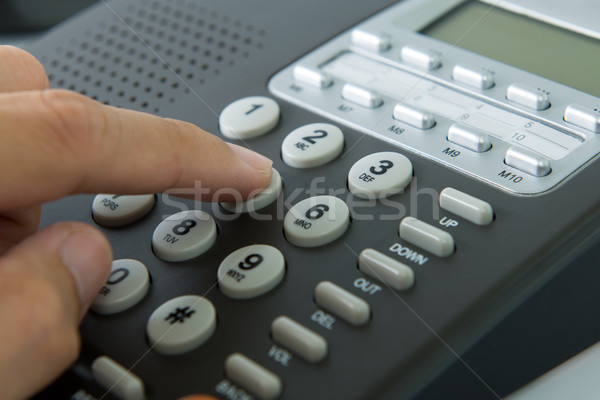 Dialing telephone Stock photo © kenishirotie