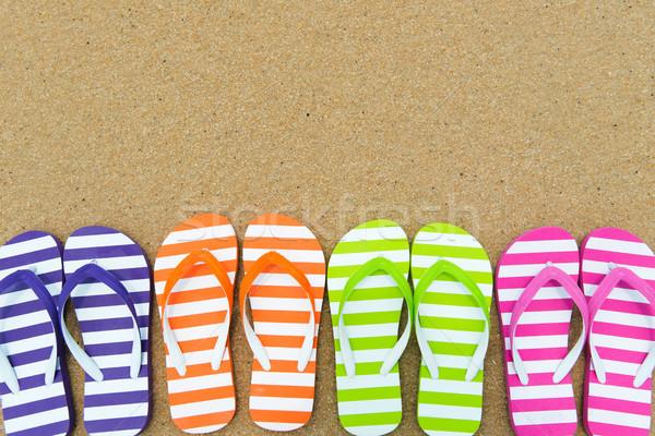 Multicolor sandals on beach Stock photo © kenishirotie