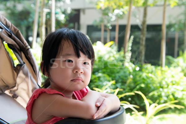 Asian child girl in stroller Stock photo © kenishirotie