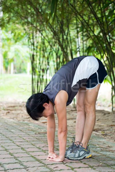 シニア 女性 行使 公園 アジア 音楽を聴く ストックフォト © kenishirotie
