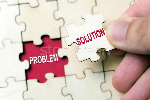 Solución problema mano pieza rompecabezas Foto stock © kenishirotie