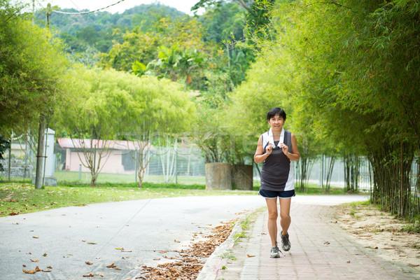 Vorderseite Ansicht Senior Frau Joggen Park Stock foto © kenishirotie