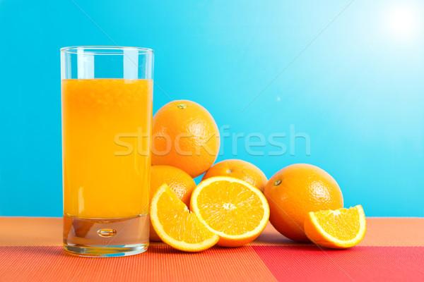 Sinaasappelsap glas sinaasappelen vruchten Blauw hemel Stockfoto © kenishirotie