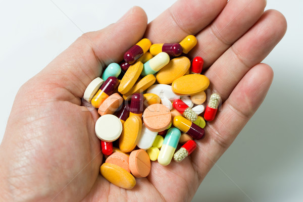 Photo stock: Main · plein · pilules · différent