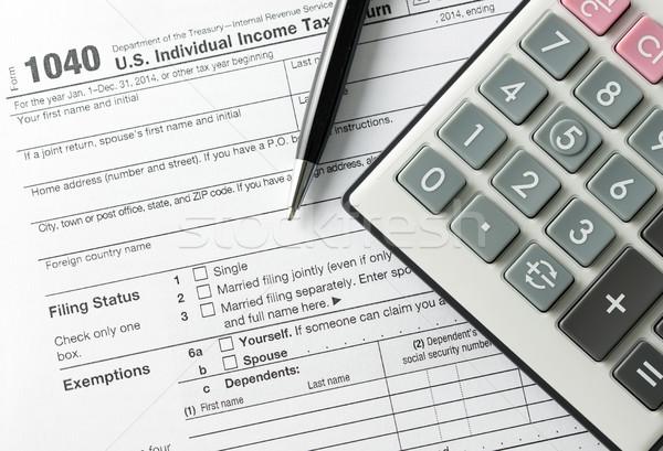 Einkommen Steuer Füllung Form Stift Rechner Stock foto © kenishirotie