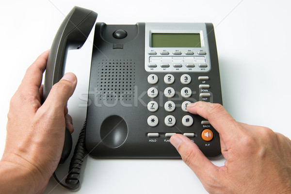 телефон человека бизнеса телефон домой Сток-фото © kenishirotie