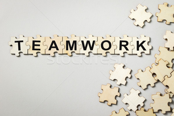 Puzzle pieces with word teamwork Stock photo © kenishirotie
