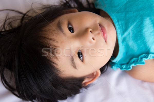 Enfant fille portrait petite fille lit Photo stock © kenishirotie