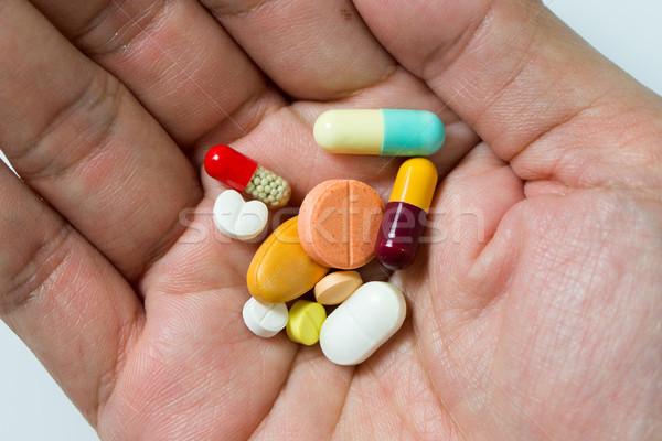 Hand voll Pillen groß unterschiedlich Stock foto © kenishirotie