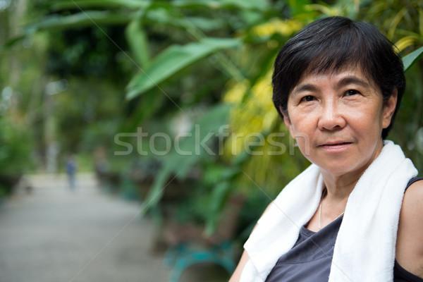 Senior Asian woman in park Stock photo © kenishirotie