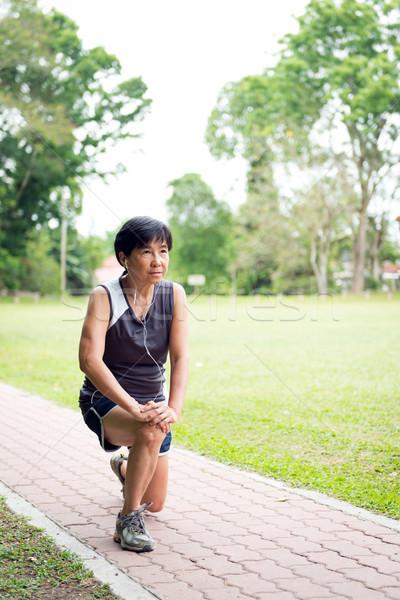 Senior woman exercising in park Stock photo © kenishirotie