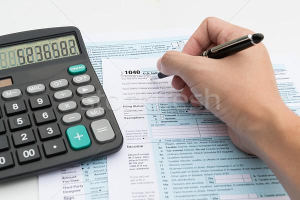 Inkomen belasting vulling uit calculator pen Stockfoto © kenishirotie