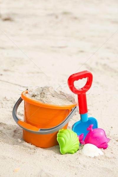 Spiaggia giocattoli colorato estate spiaggia di sabbia arancione Foto d'archivio © kenishirotie