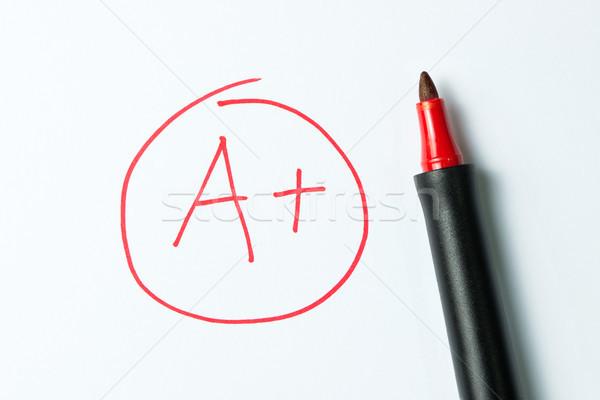 A plus written with red pen Stock photo © kenishirotie