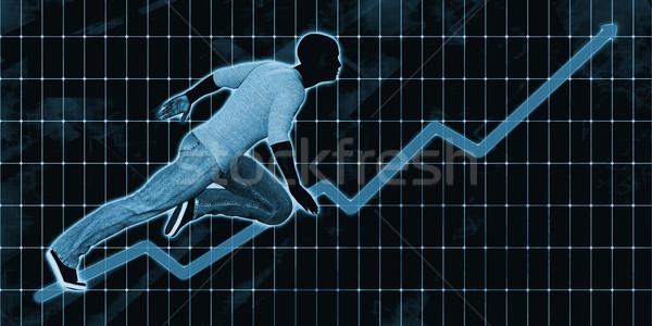 Black Businessman Charging Ahead on Blue Background  Stock photo © kentoh