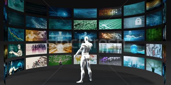 Férfi néz videofal internet fal technológia Stock fotó © kentoh