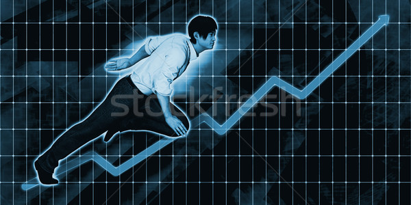 Asian Businessman Charging Ahead on Blue Background  Stock photo © kentoh