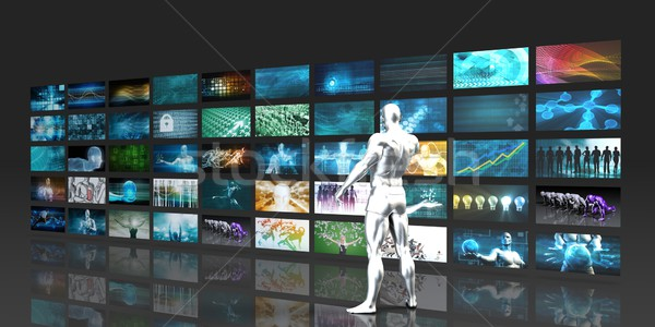 Stock photo: Man Looking into Video Wall