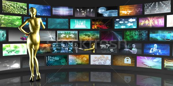 Woman Viewing Video Displays Stock photo © kentoh
