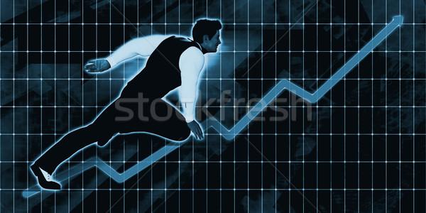 Senior Businessman Charging Ahead on Blue Background  Stock photo © kentoh
