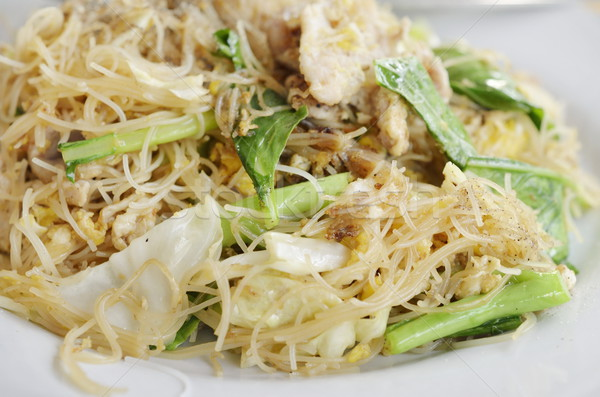 Stir Fried Rice Noodle with egg, pork and vegetable Stock photo © Kheat