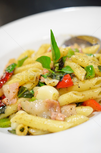 Penne pasta with ham and basil, Italian food. Stock photo © Kheat