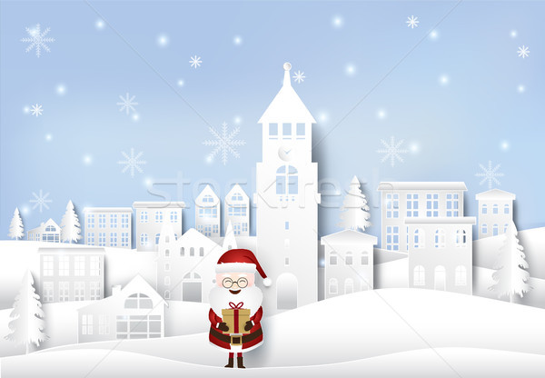 Happy winter with santa holding gift box in city town paper art  Stock photo © Kheat