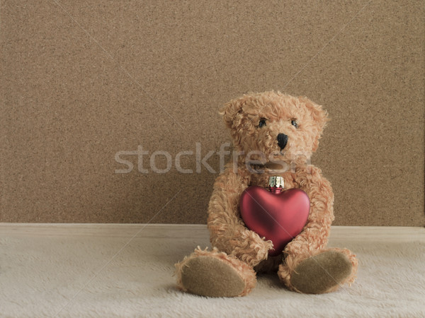 Teddy bear sitting with red heart background Stock photo © Kheat