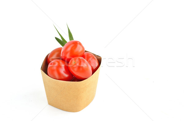 Tomatos in paper bag on white background Stock photo © Kheat