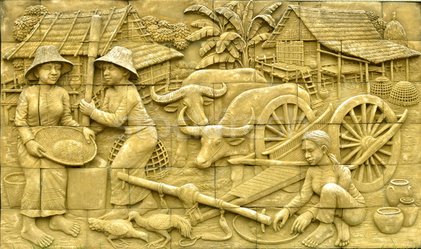 Native culture Thai stucco on the stone wall Stock photo © Kheat
