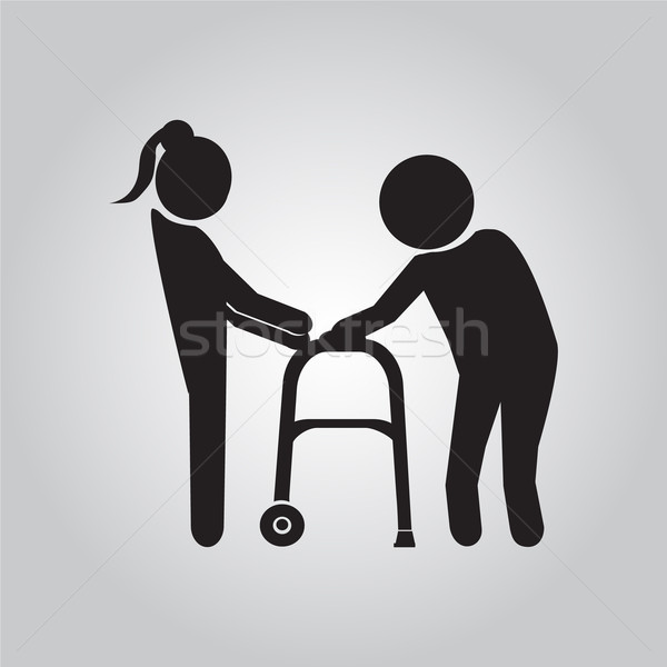 Woman helps elderly patient with a walker Stock photo © Kheat