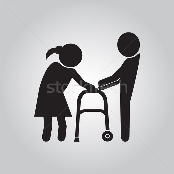 Man helps elderly patient with a walker Stock photo © Kheat