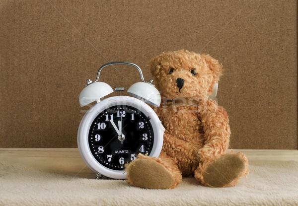Teddy bear with alarm clock on wooden Stock photo © Kheat
