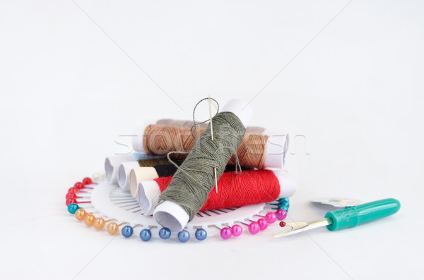 sewing accessories with pins, needle and thread Stock photo © Kheat