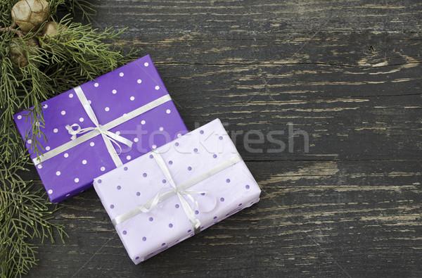 Karácsony ajándékok kettő ajándékok sötét fából készült Stock fotó © Kidza