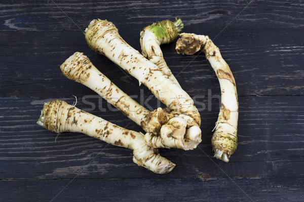 Fresh horseradish roots on wooden background Stock photo © Kidza