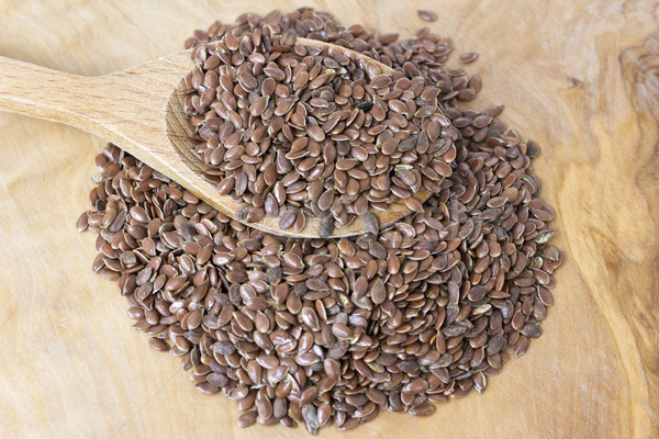 Flax seeds with a wooden spoon Stock photo © Kidza