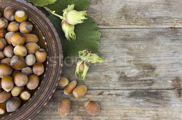 Hazelnoot houten plaat vers hazelnoten voedsel Stockfoto © Kidza