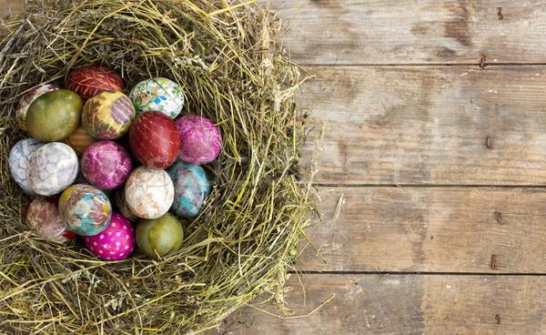 Paskalya yumurtası yuva rustik ahşap renkli boyalı Stok fotoğraf © Kidza