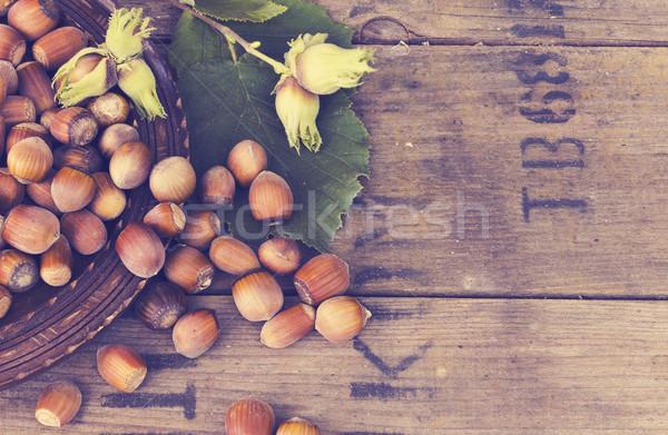 Hazelnut in bowl on wooden background Stock photo © Kidza