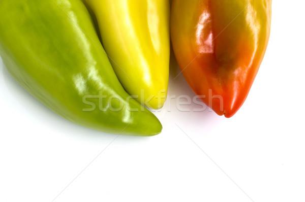 Paprika drie kleurrijk bel geïsoleerd witte Stockfoto © Kidza