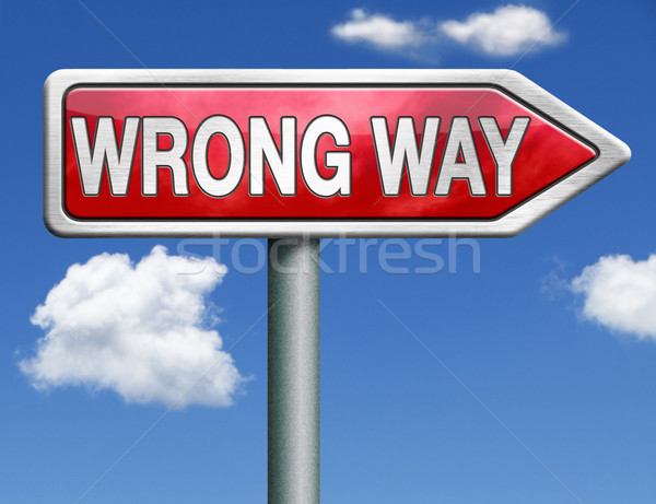 wrong way road sign arrow Stock photo © kikkerdirk