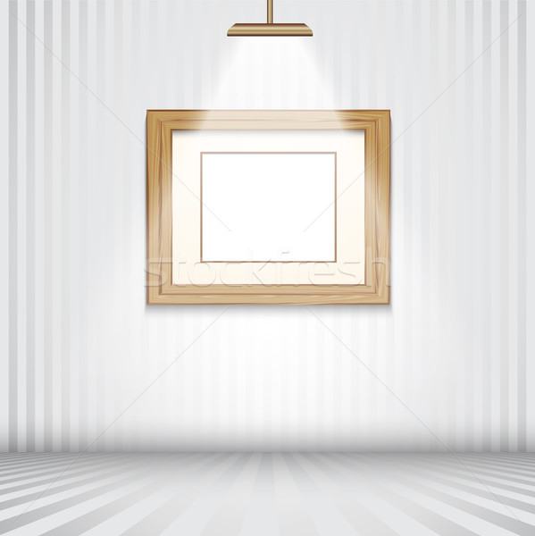 Spotlit room with empty wooden frame Stock photo © kjpargeter