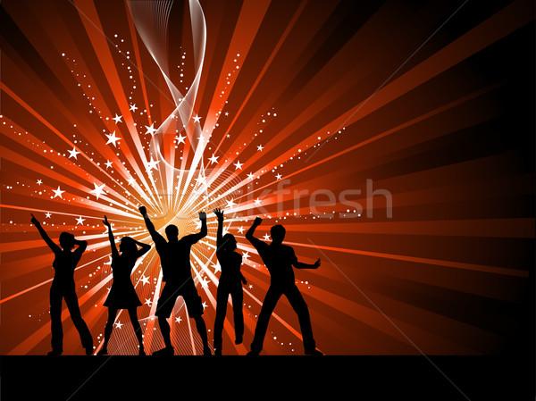 People dancing on starburst background Stock photo © kjpargeter
